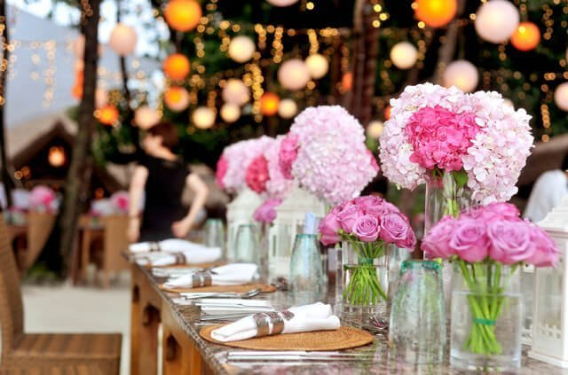 Photo of an event with bouquets of flowers on table